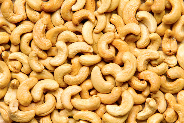 healthy food, cashews rich in heart friendly fatty acids. cashew - cashew stock photos and pictures