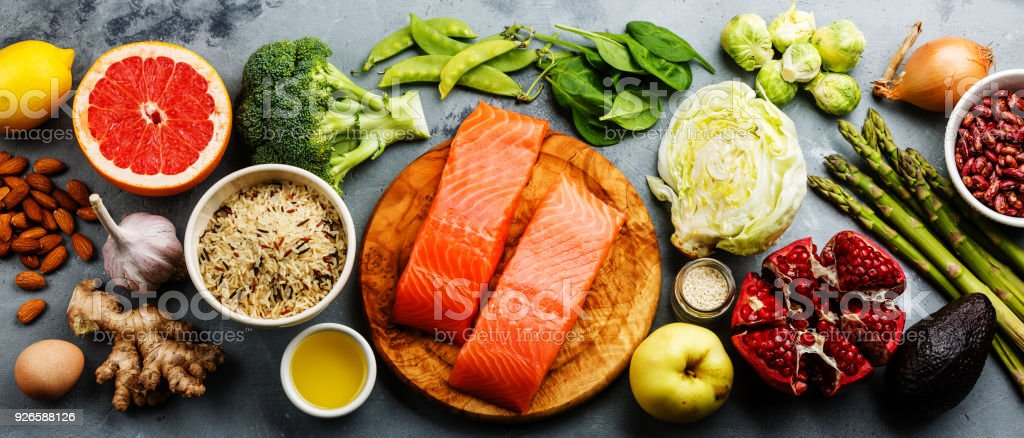 Healthy food clean eating selection: fish, fruit, vegetable stock photo