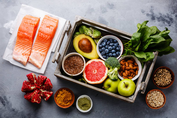 healthy food clean eating selection in wooden box - folic acid stock photos and pictures