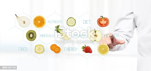 istock healthy food concept, Hand of nutritionist doctor pointing fruit 688160134