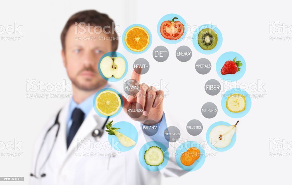healthy food concept, Hand of nutritionist doctor pointing fruit with finger stock photo