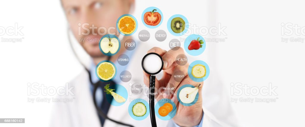 healthy food concept, Hand of nutritionist doctor pointing fruit with stethoscope stock photo