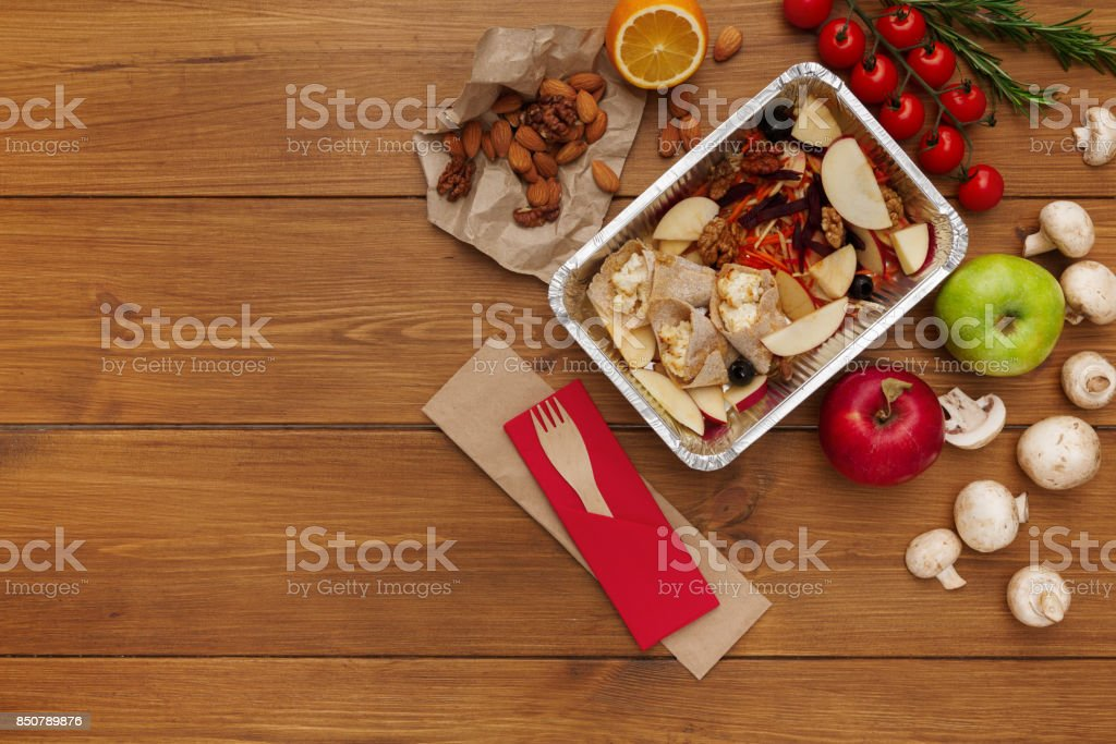 Healthy food delivery background, lunch box on rustic wood stock photo