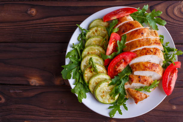 Healthy food, diet concept. Baked chicken breasts with zucchini stock photo