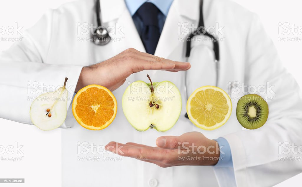 healthy food diet concept, Hands of nutritionist doctor with fruits stock photo
