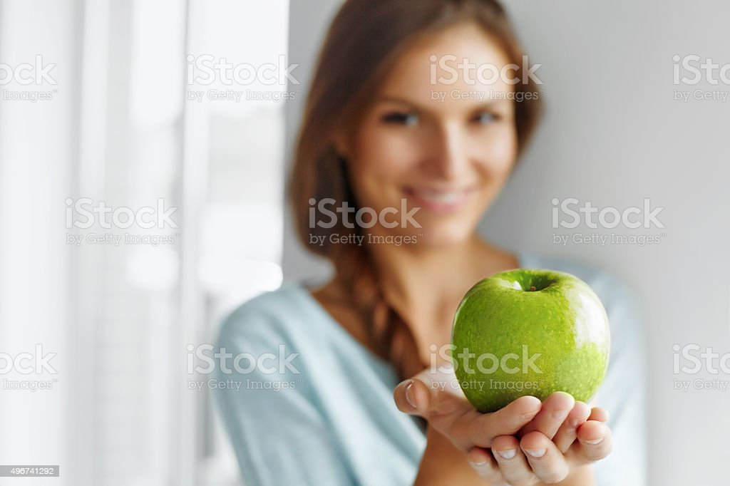 Healthy Food, Eating, Lifestyle, Diet Concept. Woman With Apple. stock photo