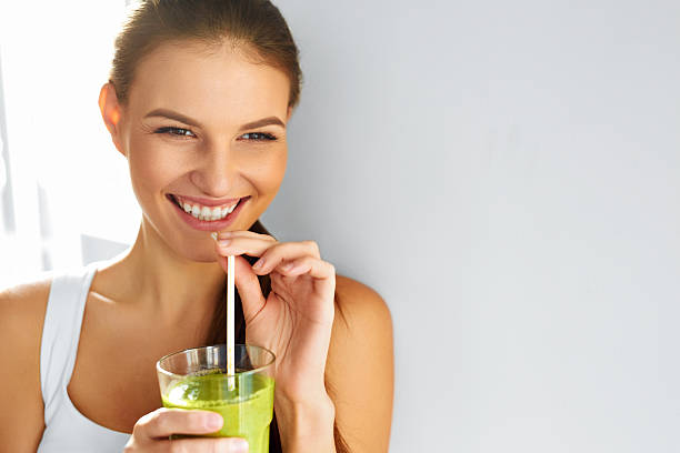 Healthy Food Eating. Woman Drinking Smoothie. Diet. Lifestyle. Nutrition stock photo