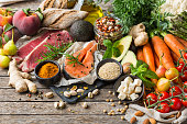 Balanced nutrition concept for clean eating flexitarian mediterranean diet. Assortment of healthy food ingredients for cooking on a wooden kitchen table.