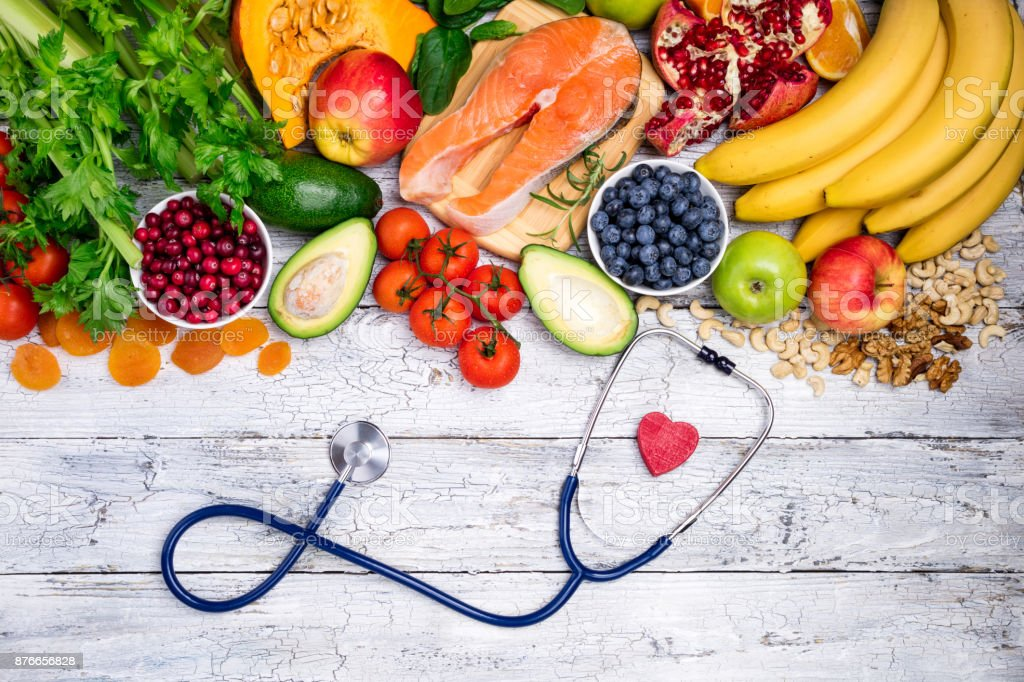 Healthy food for heart. Fresh fish, fruits, vegetables, berries and nuts. Healthy food, diet and healthy heart concept stock photo