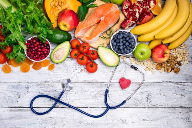 healthy food for heart. fresh fish, fruits, vegetables, berries and nuts. healthy food, diet and healthy heart concept - food and drink stock photos and pictures
