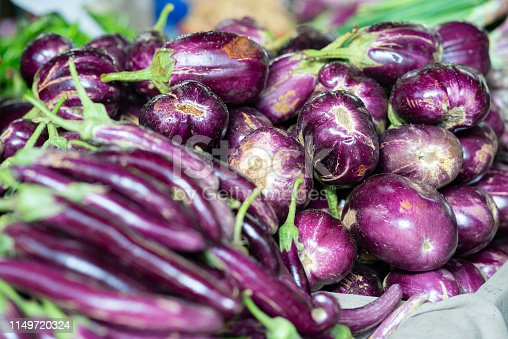 Healthy food. Fresh aubergines at the Mauritian market on an autumn day.