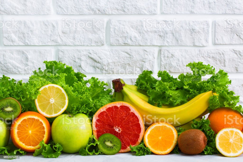 Healthy food fruits background on white painted brick wall royalty-free stock photo