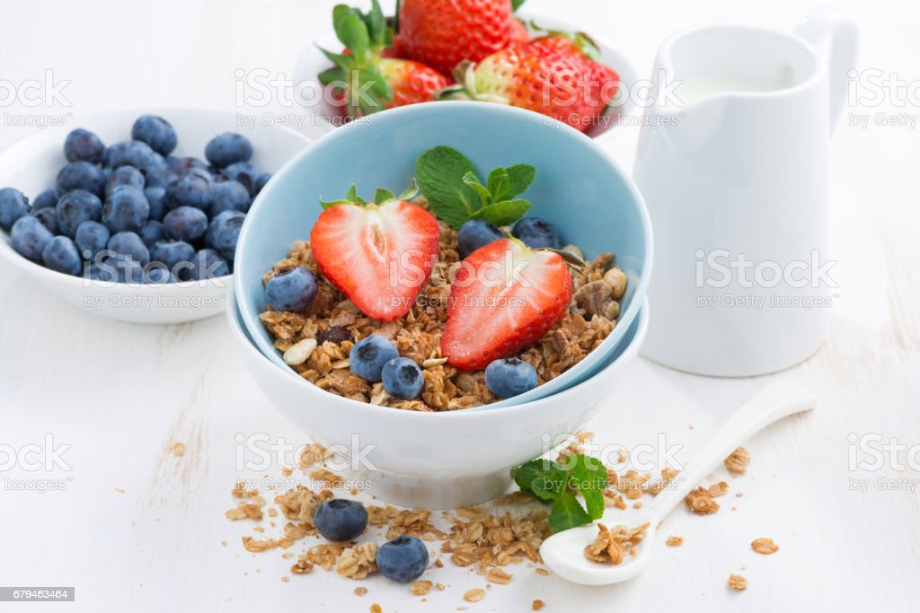 healthy food - granola, fresh berries and milk royalty-free stock photo