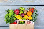 Healthy food background. Paper bag with healthy food