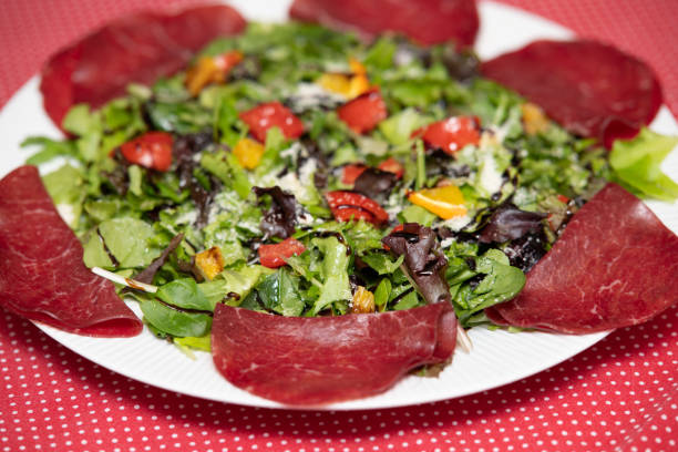 healthy food. healthy living. italian food. bresaola and mixed vegetable salad - bresaola foto e immagini stock