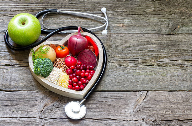 healthy food in heart and cholesterol diet concept - holistic medicine stock photos and pictures
