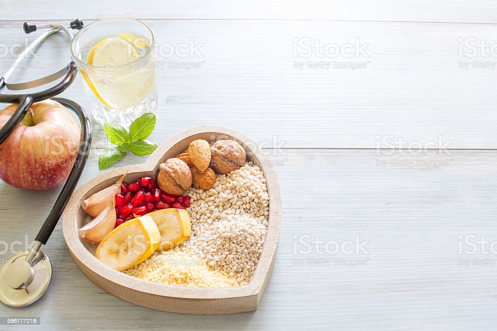 Healthy food in heart and water diet sport  concept stock photo