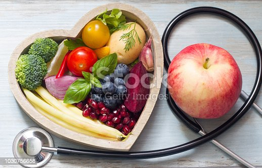 Healthy food in heart diet concept with stethoscope closeup