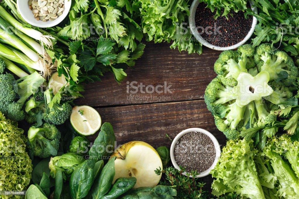Healthy food ingredients background vegetables fruit herbs superfood top view stock photo
