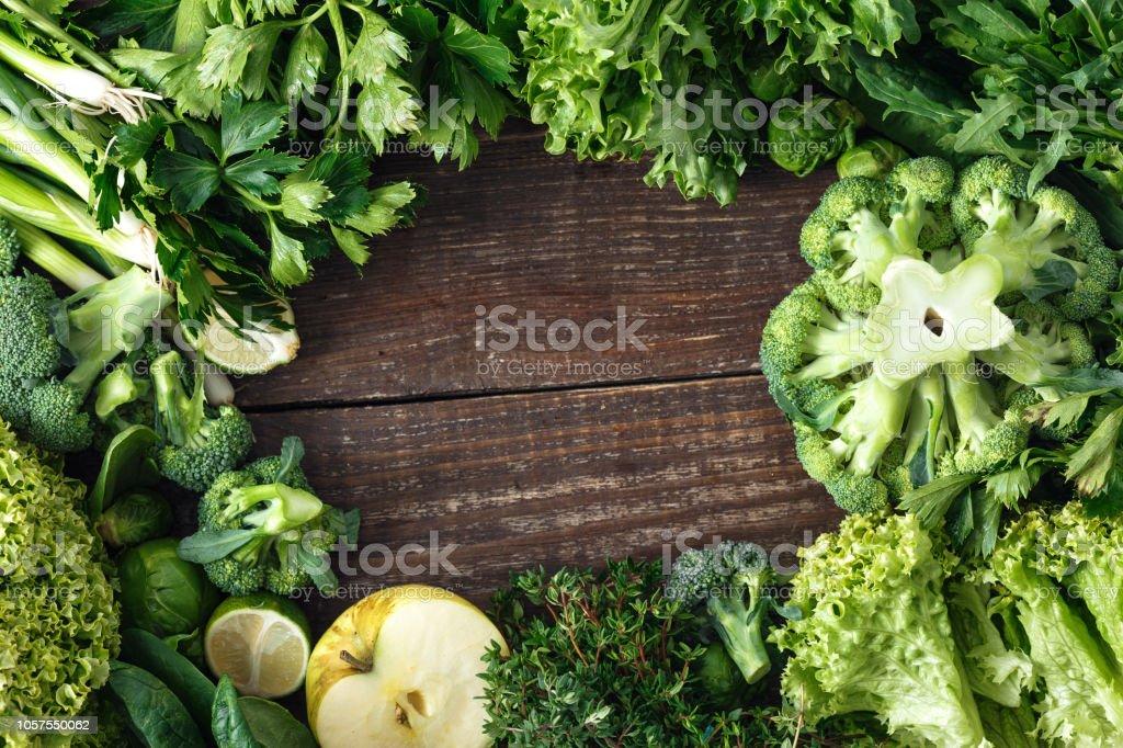 Healthy food ingredients background vegetables fruit herbs top view stock photo