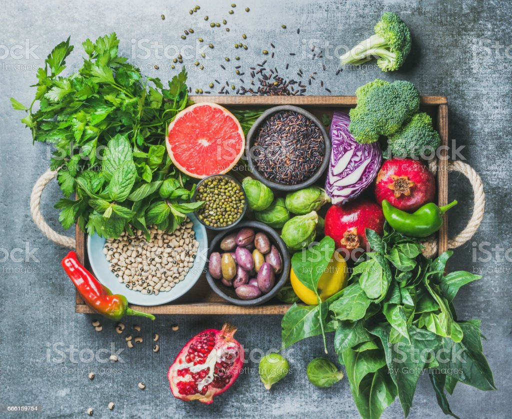 Healthy food ingredients in wooden box over grey background stock photo