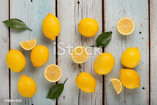 Healthy food Lemons source of vitamin C, many lemons on a blue wooden background