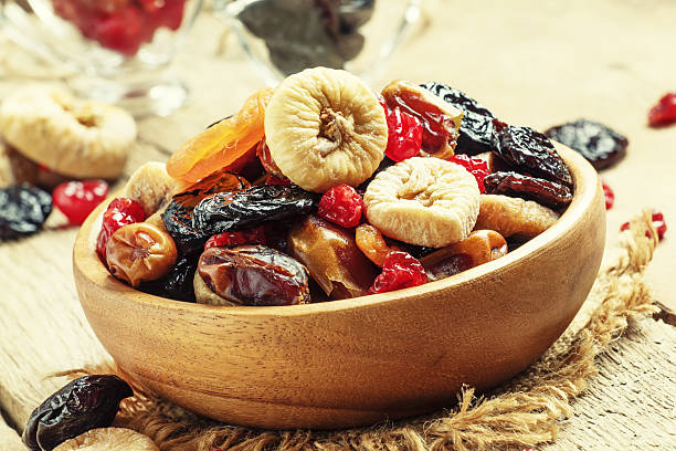 healthy food: mix from dried fruits - dried fruit stock photos and pictures