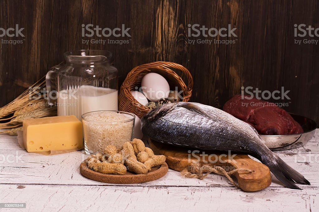 Healthy food, natural sources of protein over wooden table. Selective...
