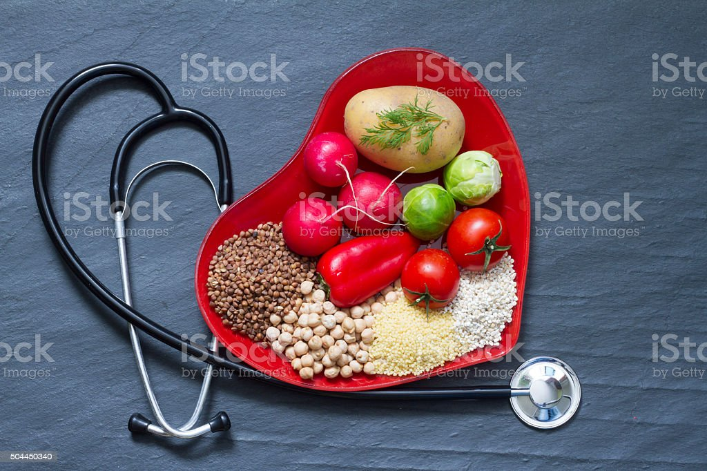 Healthy food on red heart plate healthcare concept stock photo