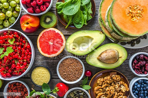 904734850istockphoto Healthy food on table, fruit assortment, nuts and seeds, superfoods selection 1067777452