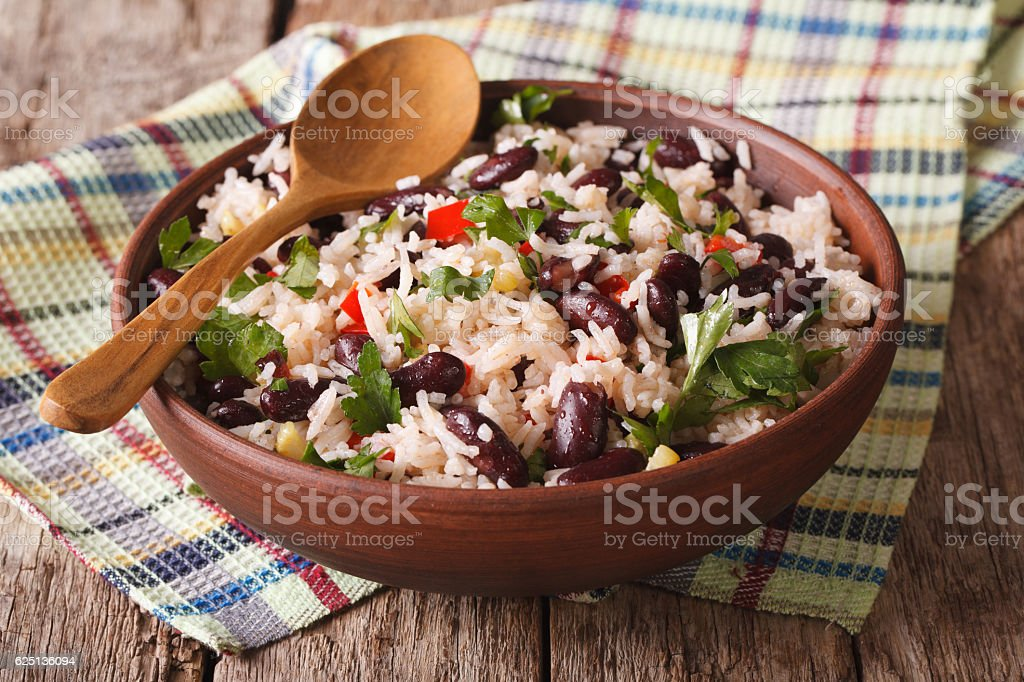Healthy food: rice with red beans in bowl close-up. horizontal stock photo