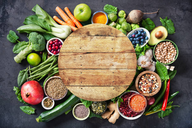Healthy food selection with fruits, vegetables, seeds, super foods, cereals stock photo