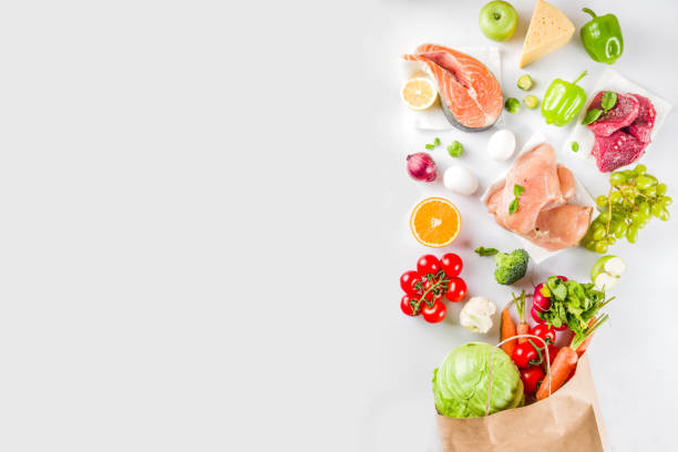 Healthy food shopping concept Healthy food shopping concept, Balanced diet ingredient - meat, fish, fruit, vegetables. Fresh foods with paper shopping bag, top view on white background copy space freshness stock pictures, royalty-free photos & images