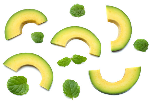 healthy food. sliced avocado isolated on white background. top view stock photo