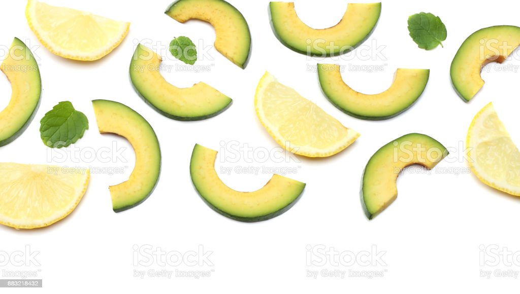healthy food. sliced avocado with lemon isolated on white background. top view stock photo