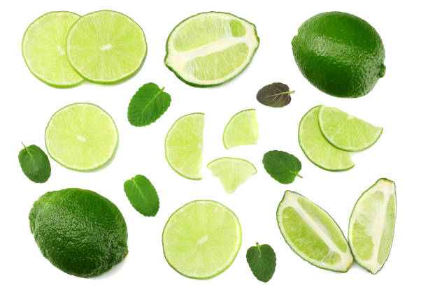 healthy food. sliced lime isolated on white background top view stock photo
