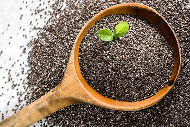 healthy food, sources omega-3 - chia seed, top view close-up on wooden spoon - chia seed stock photos and pictures