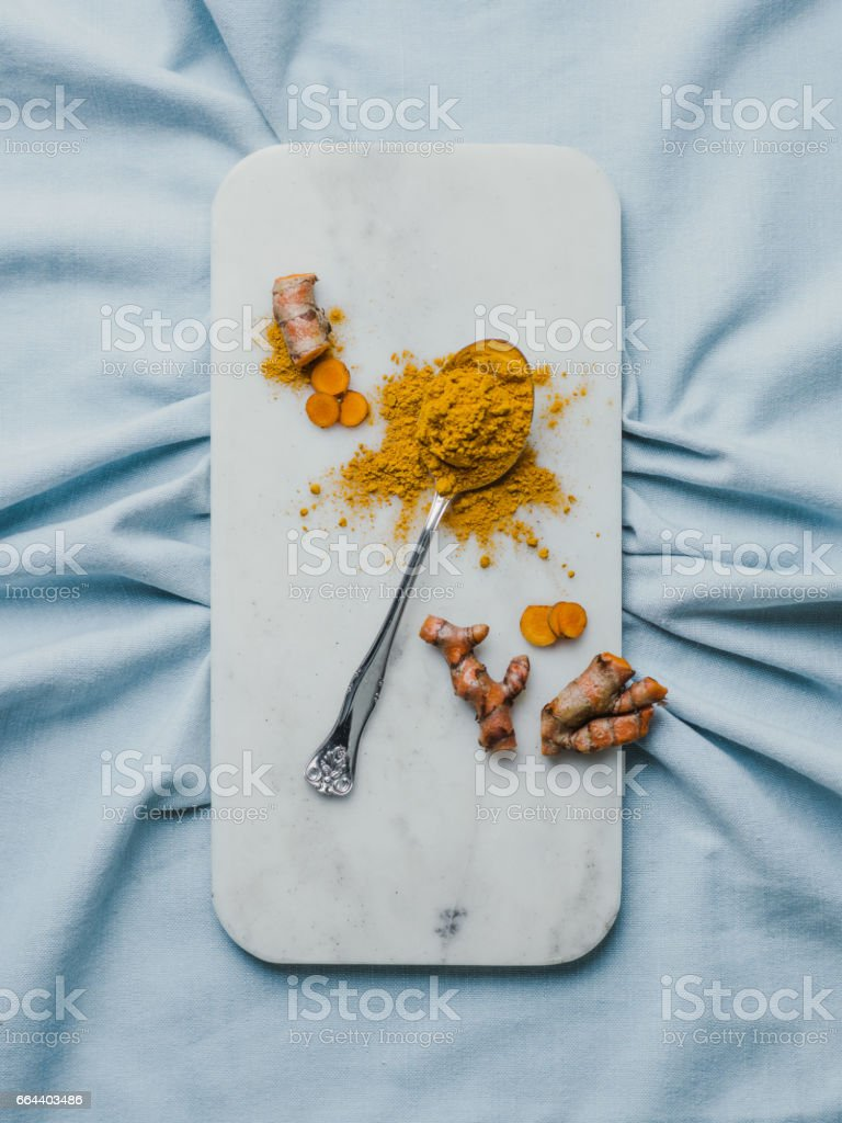 Healthy food still life Turmeric root and powder Curcuma longa stock photo