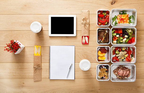 healthy food take away in boxes, top view at wood - meal stock photos and pictures