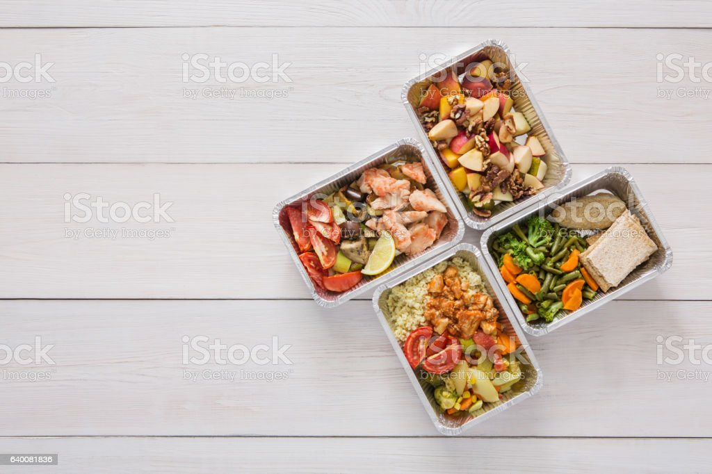 Healthy food take away in boxes, top view at wood royalty-free stock photo