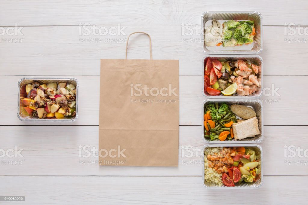 Healthy food take away in boxes, top view at wood stock photo