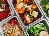 istock Healthy food take away, top view at wood background 629804696