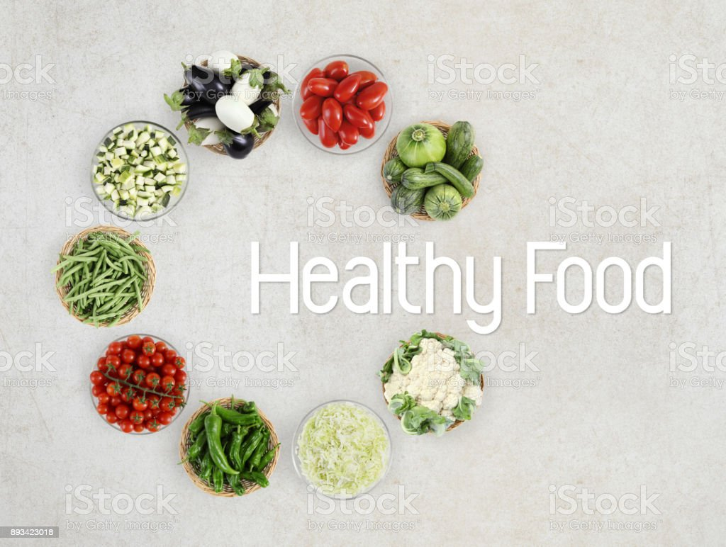 healthy food text top view vegetables isolated on marble kitchen worktop, logo and copy space template stock photo
