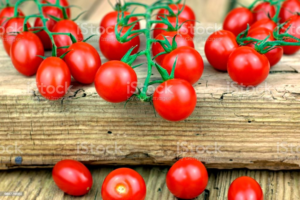 Healthy food, tomatoes and vegetable concept. - Royalty-free Basil Stock Photo