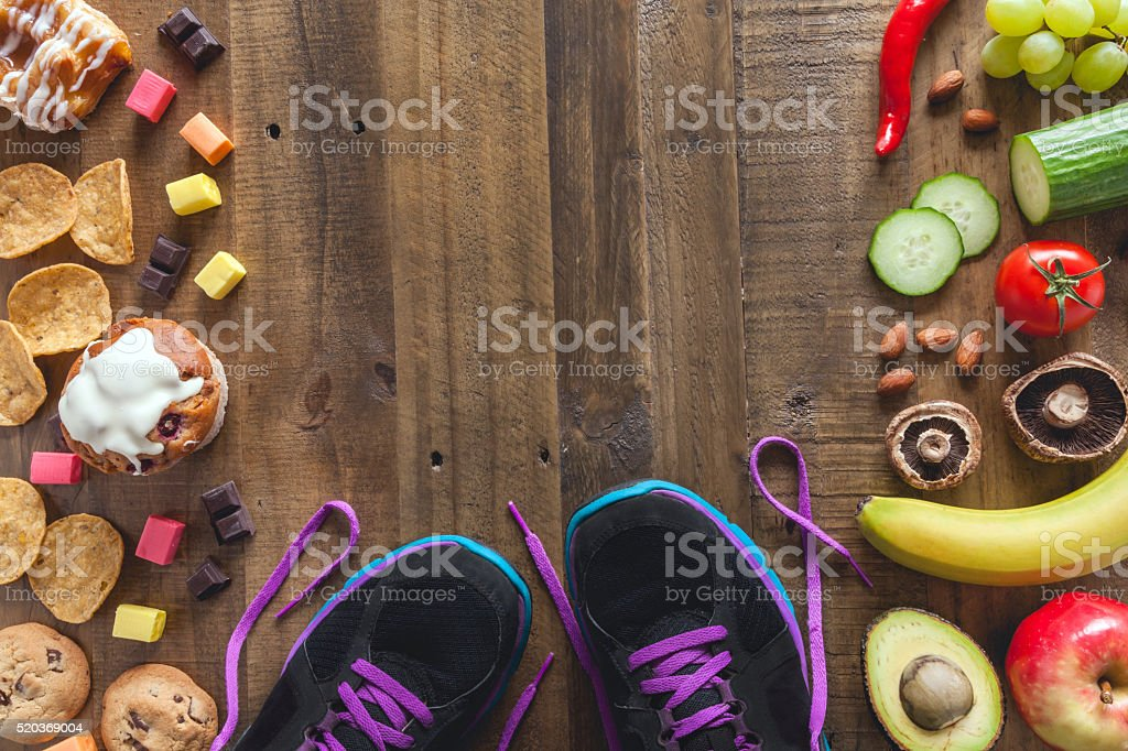 Healthy food, unhealthy food and exercise stock photo