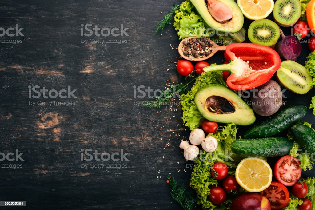 Healthy food. Vegetables and fruits On a black wooden background. Top view. Copy space. - Royalty-free Above Stock Photo