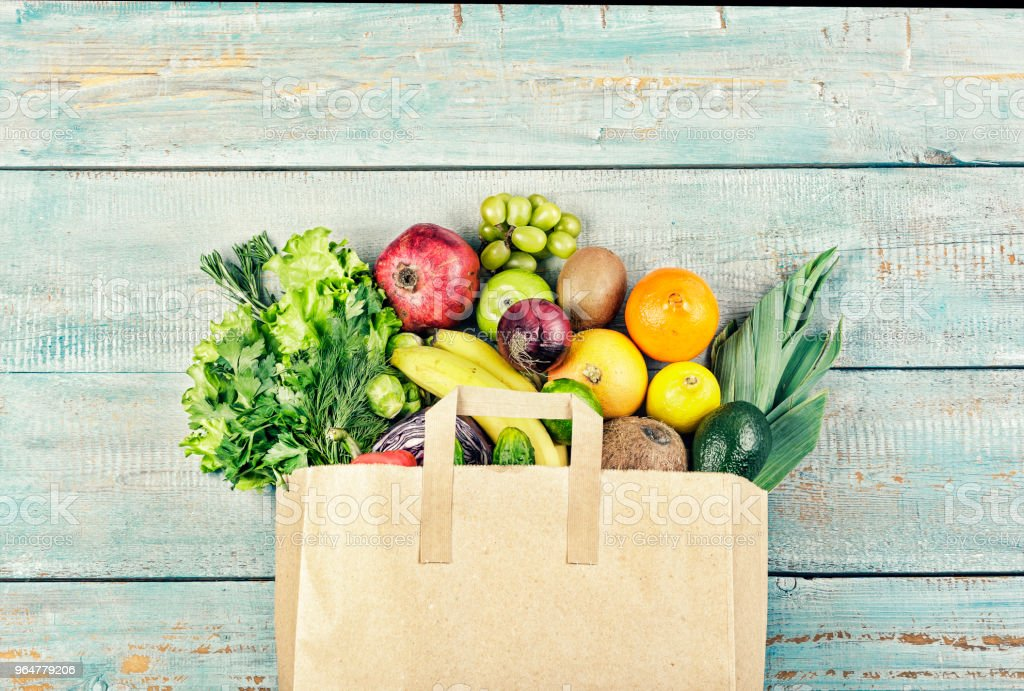 Healthy food background. Paper bag with healthy food. Grocery...