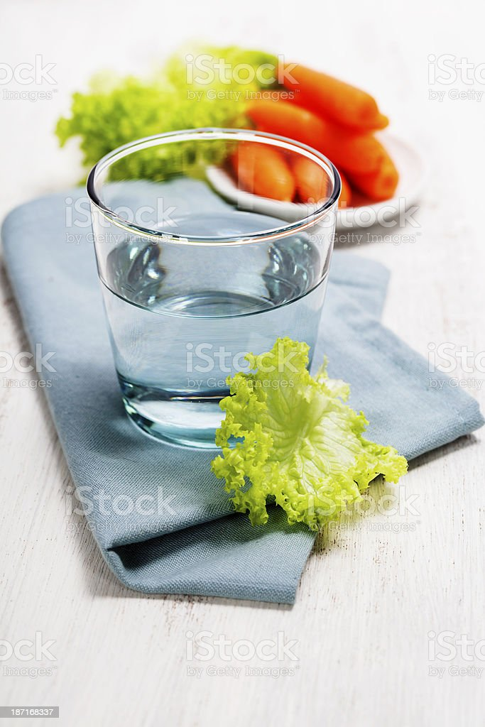 Healthy food - water, carrot and lettuce royalty-free stock photo