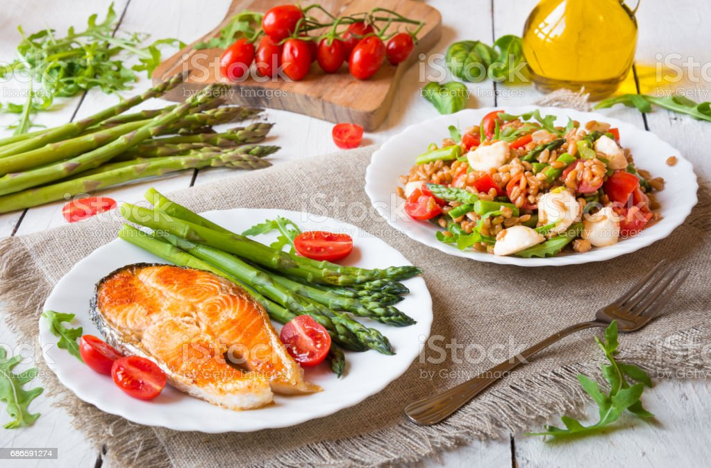 Healthy food with vegetables, salmon and salat royalty-free stock photo