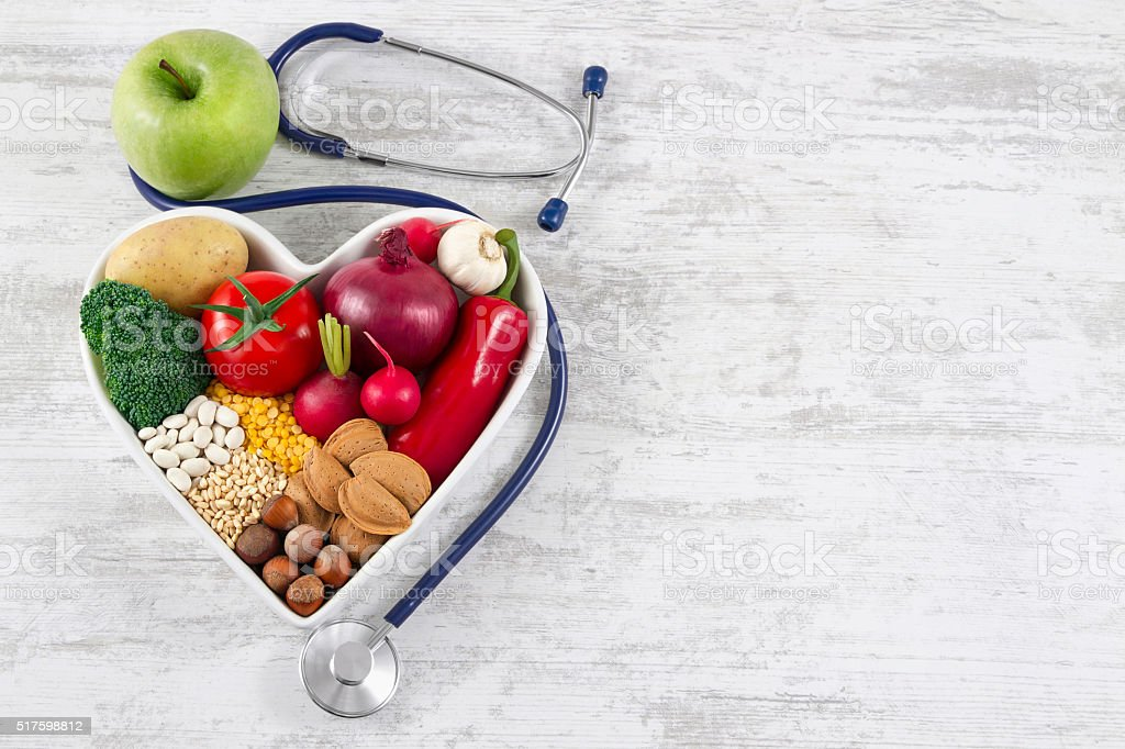 Healthy Foods in Heart Shaped with Stethoscope stock photo